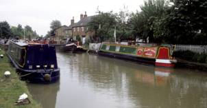 Canal boats moored on the Grand Union Canal at Stoke Bruerne