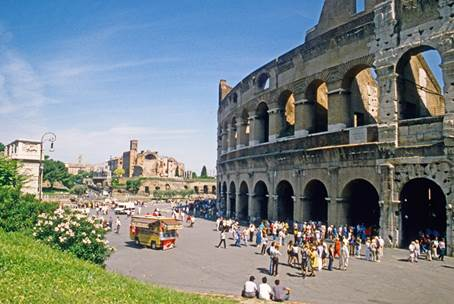 The western side of the Colosseum at Rome. A colossal statue of Nero once stood just beyond the Arch of Constantine and the lamp-post (on the left of the picture)