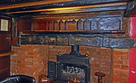 The letter-sorting rack over the fireplace in the George and Dragon Inn at Hurstbourne Tarrant in Hampshire