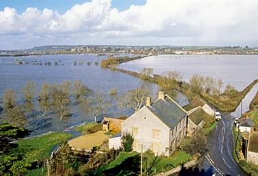 Flooding in 1990, viewed from the top of Muchelney's church tower, when the road to Langport in the distance was passable only by tractor