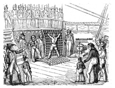 A man is tied to a grating and is about to be flogged. Everyone was required to watch.